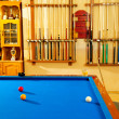 Billiard club with blue pool table cue and trophy — Stock Photo #9854222