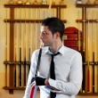 Billiard handsome young man with shirt cue and tie — Stockfoto