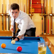Stock Photo: Billiard winner handsome mplaying with cue and balls