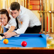 Couple playing billiard expertise teacher — Stock Photo #9855023