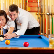 Couple playing billiard expertise teacher — Stock Photo #9855061