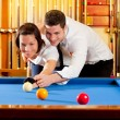 Couple playing billiard expertise teacher — Stock Photo