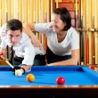 Couple playing billiard expertise teacher — Stock Photo #9855150
