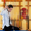 Billiard winner handsome man playing with cue — Stock Photo