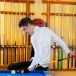 Billiard winner handsome man playing with cue - Stock Photo