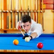 Billiard winner handsome man playing with cue — Stock Photo #9855416