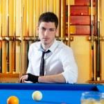 Billiard expertise man posing on blue — Stock Photo