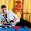 Billiard handsome player man drinking alcohol — Stock Photo #9855826