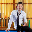 Billiard handsome player man drinking alcohol — Stock Photo #9855930