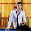 Billiard handsome player man drinking alcohol — Stock Photo