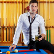 Billiard handsome player man drinking alcohol — Stock Photo