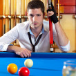 Billiard expertise mposing on blue — Stock Photo #9856042