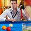 Billiard expertise man posing on blue — Stock Photo #9856064