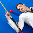 Billiard young man player lying on pool blue table — Stock Photo #9856128