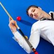 Stock Photo: Billiard young man player lying on pool blue table