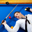 Billiard young man player lying on pool blue table - Stock Photo