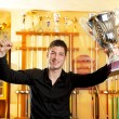 Happy proud winner man with big trophy silver cup — Stock Photo