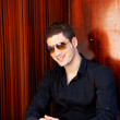Latin mediterranean handsome man with sunglasses — Stock Photo