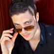 Handsome young man portrait with sunglasses — Stock Photo #9857100