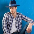 Handsome man with plaid shirt and cowboy hat — Stock Photo