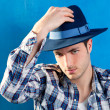 Handsome man with plaid shirt and cowboy hat — Stok fotoğraf