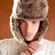 Autumn winter man with brown fur cup hat — Stock Photo #9857827