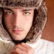 Autumn winter man with brown fur cup hat — Stock Photo #9857867