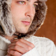 Autumn winter man with brown fur cup hat — Stock Photo #9857940