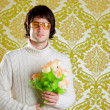 Retro hip man holding valentines flowers - Stock Photo