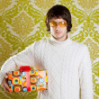 Retro hip young man glasses holding  gift box — Stock Photo