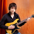 British indie pop rock look young musician guitar player — Stock Photo #9858826