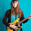 Stock Photo: Humor retro vintage hip heavy seventies guitar playe