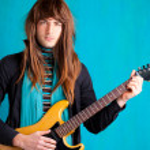 Hard rock seventies electric guitar player man — Stock Photo #9859434