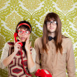 Nerd humor couple talking vintage red phone - Stock Photo