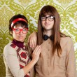 Stock Photo: Funny humor nerd couple on vintage wallpaper