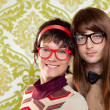 Funny humor nerd couple on vintage wallpaper — Stock Photo #9859609