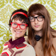 Funny humor nerd couple on vintage wallpaper — Stock Photo #9859649