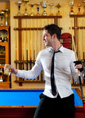 Billiard handsome young man with shirt cue and tie — Stock Photo