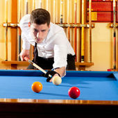Billiard winner handsome man playing with cue — ストック写真