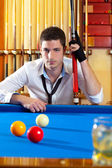 Billiard expertise man posing on blue — Stock Photo