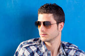 Handsome man with plaid shirt and sunglasses — Stock Photo