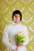 Retro hip man holding valentines flowers — Stock Photo