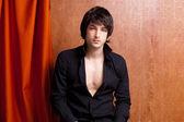 Britská indie pop rocku se mladý muž orange — Stock fotografie