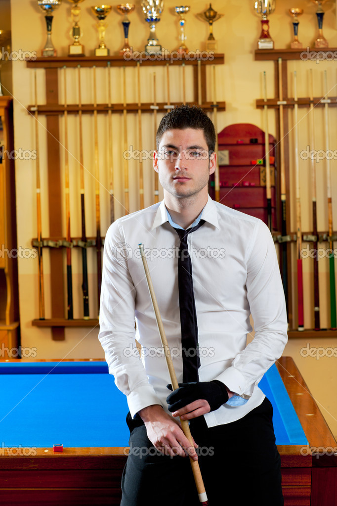 Billiard handsome young winner man with shirt tie and cue at trophy club — Stock Photo #9854387