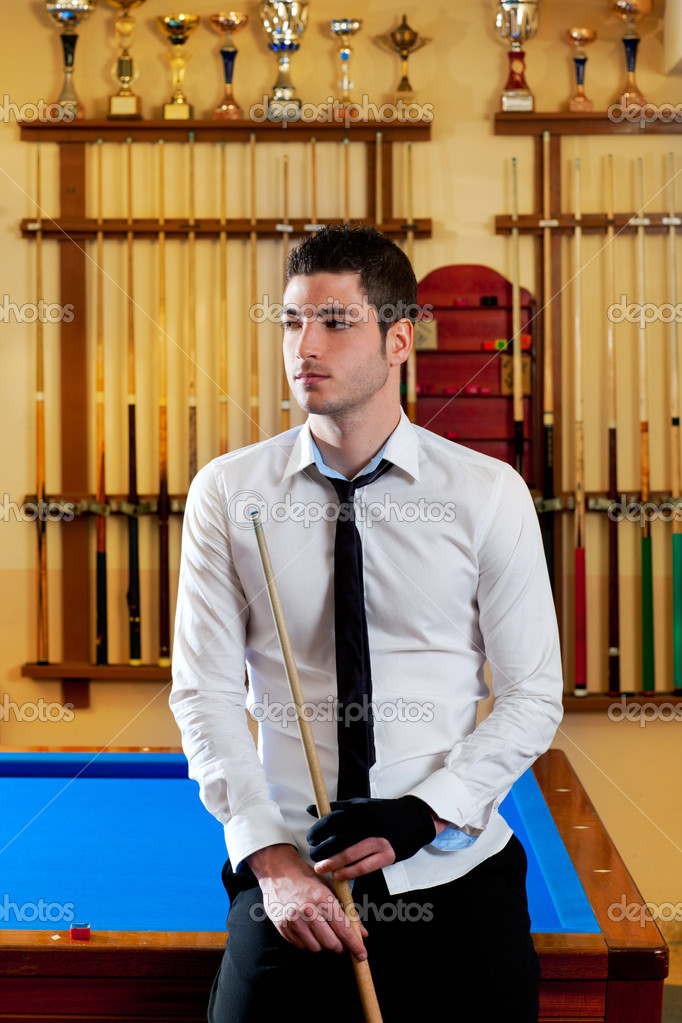 Billiard handsome young winner man with shirt tie and cue at trophy club  Stock Photo #9854461
