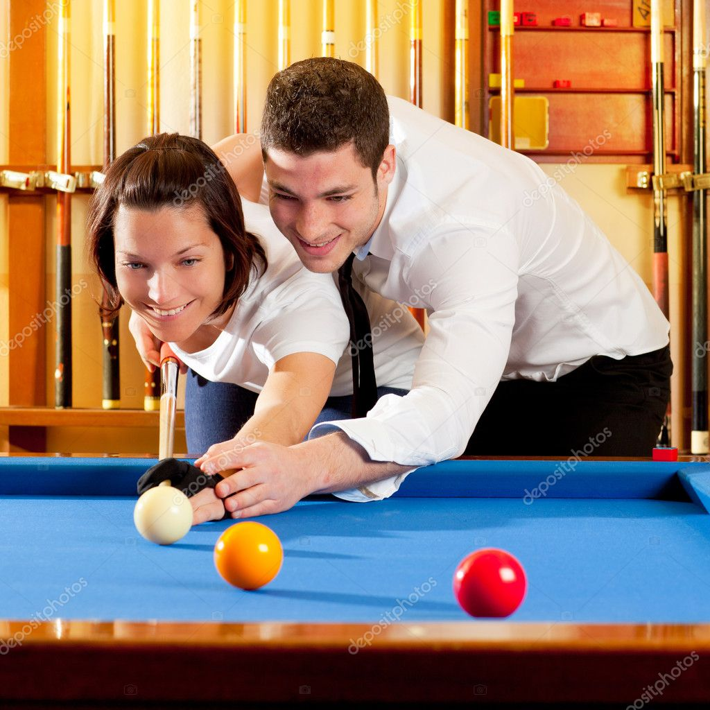 Couple playing billiard expertise teacher and beautiful girl — Stock Photo #9855093