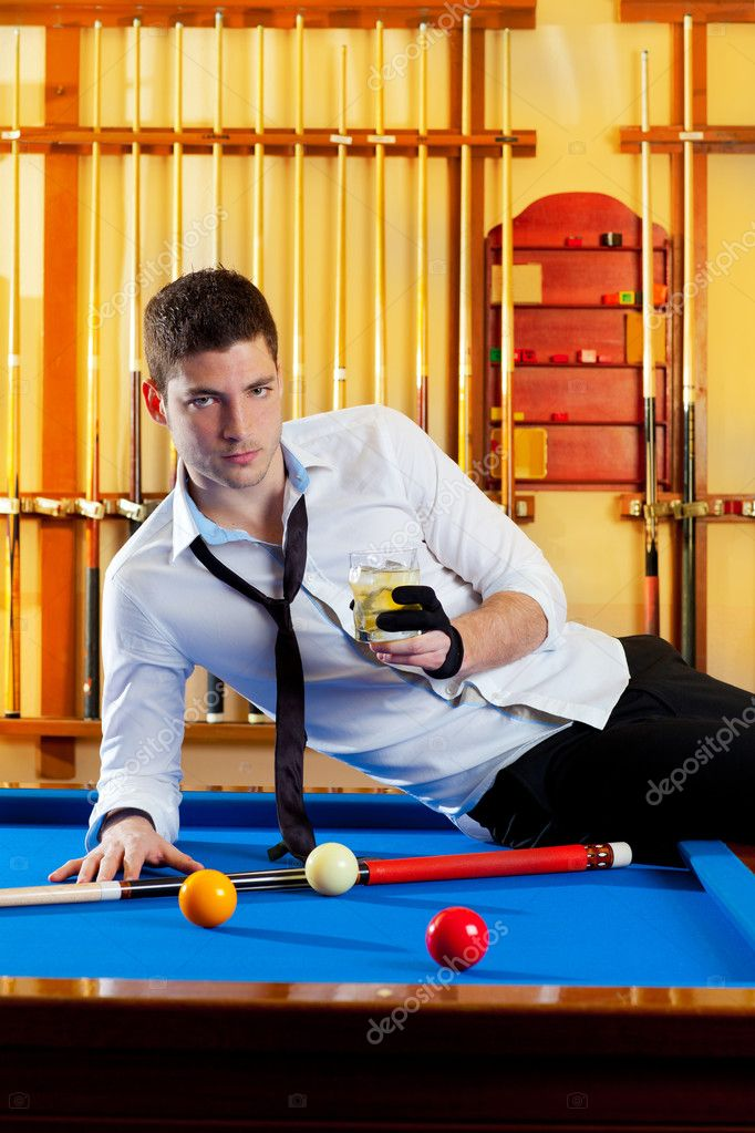 Billiard handsome player man drinking some alcohol in club  Stock Photo #9855645
