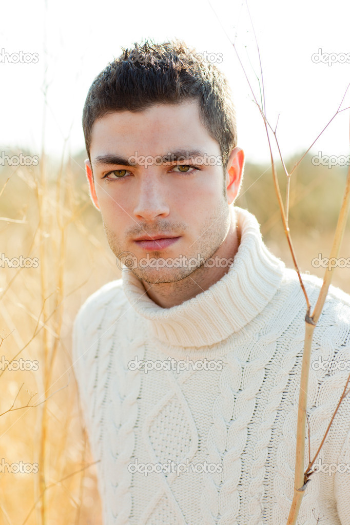 Autumn winter man portrait in outdoor dried grass field with turtleneck sweater — Stock Photo #9857256