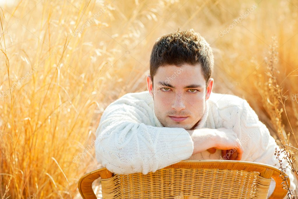 Autumn winter man portrait  in golden grass field with turtleneck sweater  Stock Photo #9857327