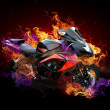 Motorcycle in wild flames — Stock Photo